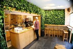 take design queues from this cute coffee shop and frame an entrance way with a refreshing burst of nature