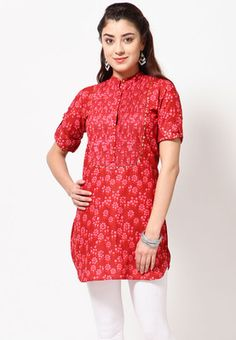 Red coloured kurta for women from Folklore. Made of 100% cotton, this thigh-length kurta has roll-up sleeves and a mandarin collar. It comes in regular fit.