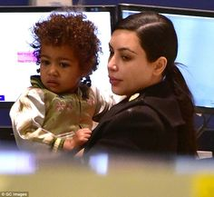 Jet-set family: Kim Kardashian was spotted at JFK airport with North just before 6am on Thursday