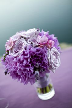 Bridesmaid bouquet in vase, in lavenders and purples - Roses, Dahlias, Freesia - by Heather Murdock of The Blue Orchid (image by Silvana Di Franco)