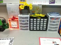 """A writing center is hands down one of the best centers in a classroom. It also has the most academic potential of any literacy center. In a writing center, kids should be busy with """"the work"""" - real writing for a real purpose and a real audience.  This one is neatly organized and has lamps."""