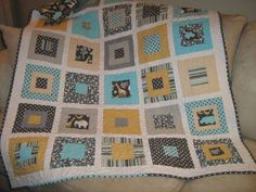 Zoology Baby Boy Quilt. $125.00, via Etsy.