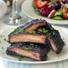 Blueberry Barbeque Ribs - our easy homemade  blueberry barbeque sauce is simply outstanding on slow cooked, fall-off-the-bone tender ribs.