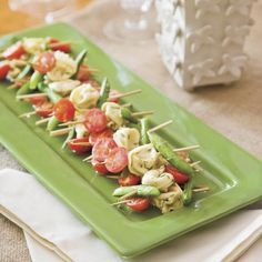 This party-perfect appetizer features tortellini, sugar snap peas and tomatoes threaded on skewers and marinated in tangy mustard vinaigrette.
