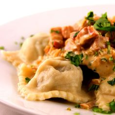 Homemade pasta ravioli filled with three types of mushroom and garlic. Served with a creamy parmesan and pancetta sauce.