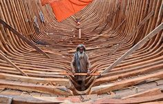 A carpenter works on a fishing boat at the harbor in Karachi, Pakistan - The Christian Science Monitor - CSMonitor.com