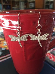 https://developers.pinterest.com/rich_pins_product/ 25% off! These beautiful, glistening dragonflies would add the perfect amount of sparkle to any outfit. They would hang a little over 1.5 inches. The charms are sterling silver with glistening cubic zirconia, and the earrings are sterling silver as well. Earring backs included. A