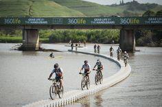 Bikes on the 800m DOCKPRO bridge for the Sani2C final day Finish. (Photo by Cherie Vale)