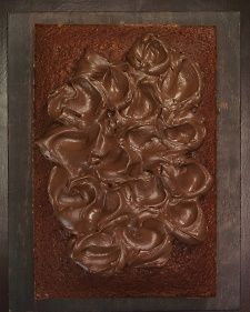Chocolate Frosting - Martha Stewart Recipes. whole recipe was enough to just cover 2 cakes. made with cream cheese, sour cream, butter, melted chocolate.  tasted very much like chocolate cheese cake.
