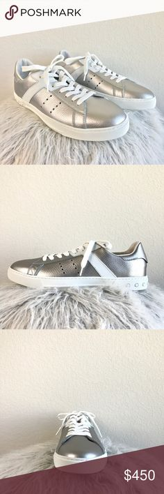 TOD'S silver leather lace up sneakers Rounded toe lace up leather sneakers. Tonal topstitching. Color: silver and white. Leather upper. Leather lining. Leather insole. Rubber outsole. Size: 10 - fits up to size 10.5. NWB. Comes in original box and dust bag. Can provide more info and pictures upon request. Tod's Shoes Sneakers
