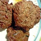 Boiled Hamburgers.  Mix them like you want with whatever ingredients you use, then half fill a frying pan, bring water to a boil, and add patties. Cook until done, pour off water, and fry until they start to turn dark. This keeps them moist and flavoriful. Try it!