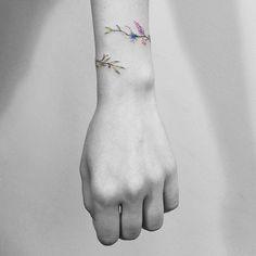 Floral bracelet tattoo by Vitaly Kazantsev. #VitalyKazantsev #flower #floral #bracelet#band #lovely #subtle #fineline
