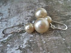 """Vintage Faux pearls were used to make these earrings.   I was given a Jewelry inheritance and there were many broken necklaces. I used some a these beads to make new pieces. These hang on silver tone ear-wires.    Measurements:   USA 1""""   METRIC 2.5cm"""