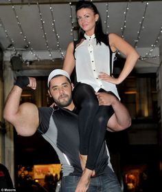 Meet the real-life Popeye and his 31 inch biceps (which are as big as a grown-man's waist! Model Jessica Jerrard gets a lift from Moustafa Ismail, 24, who has the largest biceps in the world and is visiting London to launch the new Guinness Book of Records