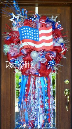 PATRIOTIC WREATH with an AMERICAN FLAG and STREAMERS