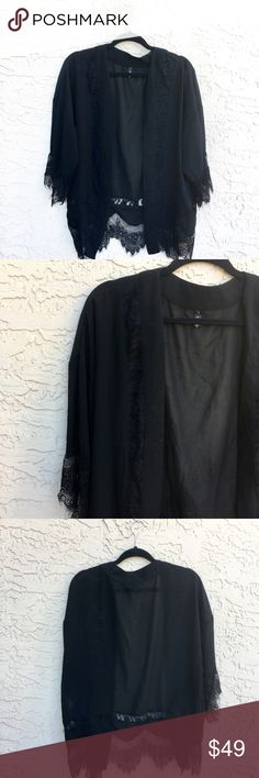 Black lace and sheer kimono The perfect black kimono with sheer and lace. Great condition. Size L. But I would say one size fits most because it's kimono style Boutique Tops