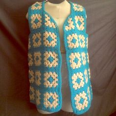 "Vintage Handmade Crochet Squares Vest Totally cool and straight outta the 70's this vintage vest is handmade with a crochet squares in a medium weight yarn. It has a open front with scalloped edging and measures 27"" from the shoulder to the bottom and approx. 9"" across the back when laying flat.  Looks fabulous with a pair of jeans or mini skirt and boots!! Vintage Other"