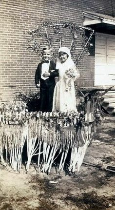 Richard Carrington and Carolyn Harrell, 4 yrs old, as bride and groom on a Cheese Carnival Float, Collierville #Tennessee. June 1935