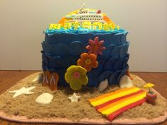 A cruise, tropical beach themed birthday cake.