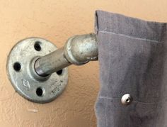 Neat idea for hanging curtains- would be cool for a man cave or boys room