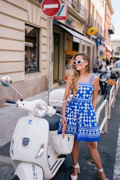 Discover the brightly colored seaside town of Villefranche-Sur-Mer through the lens of Julia Engel of Gal Meets Glam on her trip to the French Riviera. Vespa Bike, Vespa Scooters, Piaggio Vespa, Vespa Lambretta, Motor Scooters, Ny Dress, Castaner Espadrilles, Villefranche Sur Mer, Scooter Girl