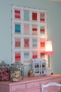 A Little Bit Biased: Finished Spools quilt... Love the scarp storage on display too