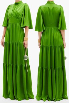 Andrew Gn Green Silk Tiered Dress. What to wear for an Autumn Wedding 2020. Autumn Wedding Guest Outfits. How to wear Green 2020. Spring Wedding Guest dresses 2021. Outfit ideas with Green. Andrew Gn's fascination with 19th century silk textile production in Lyon led to the creation of this exquisite green gown. Fluid silk satin with graceful fluted sleeves, gathered bodice and sweeping tiered skirt. #fashion #fashionista #maxidress #silkdress #autumnwedding #fallfashion #andrewgn #ootd