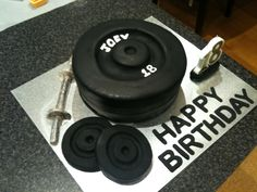 Black weights birthday cake for a gym junkie.