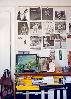 The wall of inspiration in photographer Cody Cloud and Julia Galdo is filled with images from an old Olympics book.