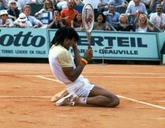 Although I don't have an still, the image of Yannick Noah hitting the first every 'tweener' I saw will forever be ingrained in my memory.