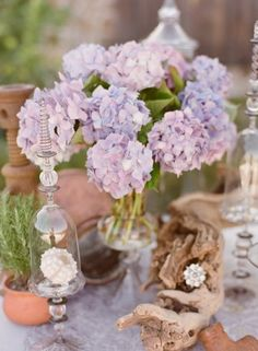 Purple Hydrangea Wedding Centerpiece......Becca you could do this with blue hyrdangea!