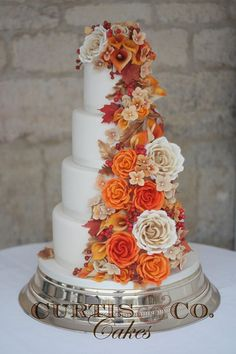 Stunning fall themed wedding cake with warm reds, oranges and creams; via Curtis & Co. Cakes