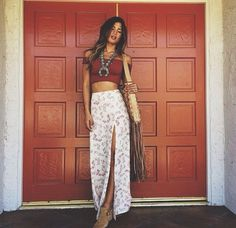 Red crop top and long white skirt with slit
