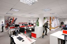 Love the wall graphic used at Konami, not to mention the life size soldier they have in the middle of the office. Cool office design!