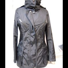 Burberry coat Gorgeous  100% Authentic Burberry London Black Nylon Rain Coat! Worn gently once! Like New Burberry Jackets & Coats