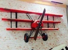 The red baron custom airplane wall shelves for boys who like toys Airplane Room, Airplane Decor, Airplane Lights, Wall Bookshelves, Wall Shelves, Wood Projects, Woodworking Projects, Aviation Decor, Red Wall Art