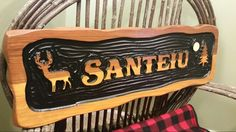 A premium carved rustic cedar sign with Sikkens finish by Adirondack Jim. Www.adirondackjims.com