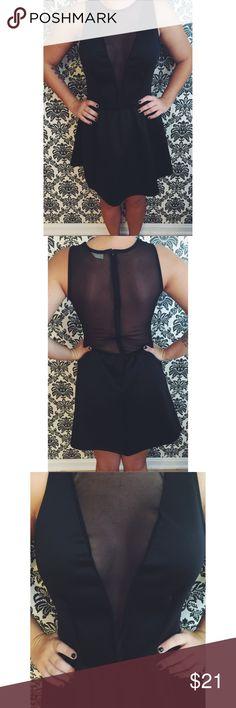 Black Skater Dress Black skater style dress with sheer deep v neck. Sheer back as well. Stretchy and Super flattering for any body type! Never worn. Tobi Dresses