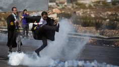 When a well-dressed Palestinian lawyer was photographed punting a tear gas canister with a flying kick back toward Israeli soldiers, the internet took it up an opportunity for fun, but the image has also connected the social media world with tensions in the Old City of Jerusalem.