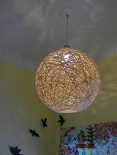 An awesome DIY Twine Light Fixture. I could see this being done in other materials as well to  fit your design aesthetic.