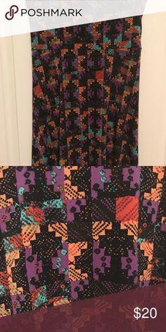 "XS LuLaRoe Maxi skirt Excellent used condition XS LuLaRoe Maxi skirt. 96% polyester, 4% spandex. ""Slinky"" material. Black background with purple, orange, aqua, and adobe red geometric pattern. LuLaRoe Skirts Maxi"