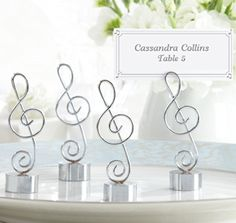 "Love Songs Silver-Finish Music Note Place Card/Photo Holder (Set of If music be the food of love, play on. Immortal wordsfrom William Shakespeare and wonderful reason to favor your guests with""Love Songs"" Place Card/Photo Holder, Kate Aspen's Elegant Wedding Favors, Wedding Favours, Unique Weddings, Party Favors, Wedding Reception, Wedding App, Wedding Ideas, Reception Table, Post Wedding"