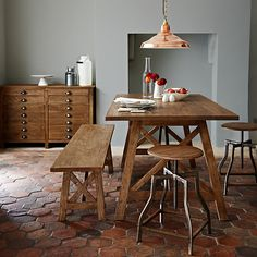 Terracotta floor tiles / art studio drawers / bronze lighting