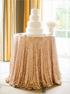 Sparkly gold table cloth with white wedding cake