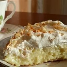 Old Fashioned Coconut Cream Pie - Sweetened toasted coconut is stirred into a homemade custard filling and poured into a pie shell. After the pie is chilled and set, it's covered with whipped topping and more toasted coconut,,