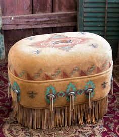 The Buffalo Spirit Ottoman in deer suede symbolizes the spiritual relationship between the buffalo and the American Indian. The ancient native art of hide painting inspires Patricia Wolf's ar… American Indian Decor, Native American Decor, Native American Fashion, Indian Home Decor, Southwest Decor, Southwestern Decorating, Western Furniture, Rustic Furniture, Cabin Furniture