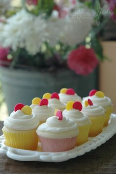 Mini lemon cupcakes with lemon cream cheese frosting by adeline
