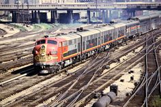 https://flic.kr/p/EDggcQ | ATSF, Chicago, Illinois, 1972 | Santa Fe F-unit no. 300 leads an Amtrak passenger train in Chicago, Illinois, on August 18, 1972. Photograph by John F. Bjorklund, © 2015, Center for Railroad Photography and Art. Bjorklund-04-10-19