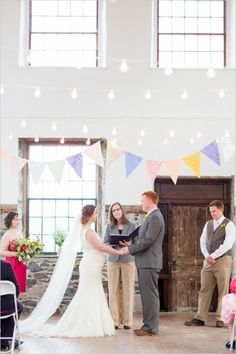 Cute wedding ceremony with strands of lights and pastel bunting. #weddingceremony #weddingdecor #weddingchicks Captured By: Rodeo & Co Photography ---> http://www.weddingchicks.com/2014/04/28/reveal-your-babys-gender-with-this-cute-wedding-idea/