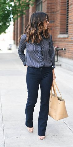 Our ultra flattering Logan-fit pant in denim is the perfect addition to your wardrobe. Pair our premium dark denim pant with a feminine blouse to get an effortlessly chic look, just like @crystalinan. Bonus, it has stretch! Shop now | Banana Republic